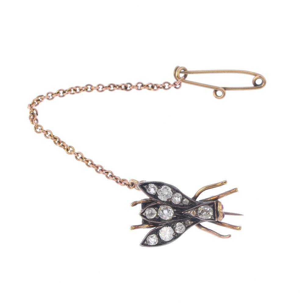 A late Victorian silver and gold diamond fly brooch.