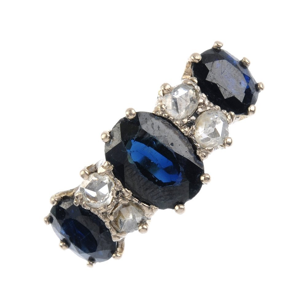 A sapphire and diamond dress ring. The graduated