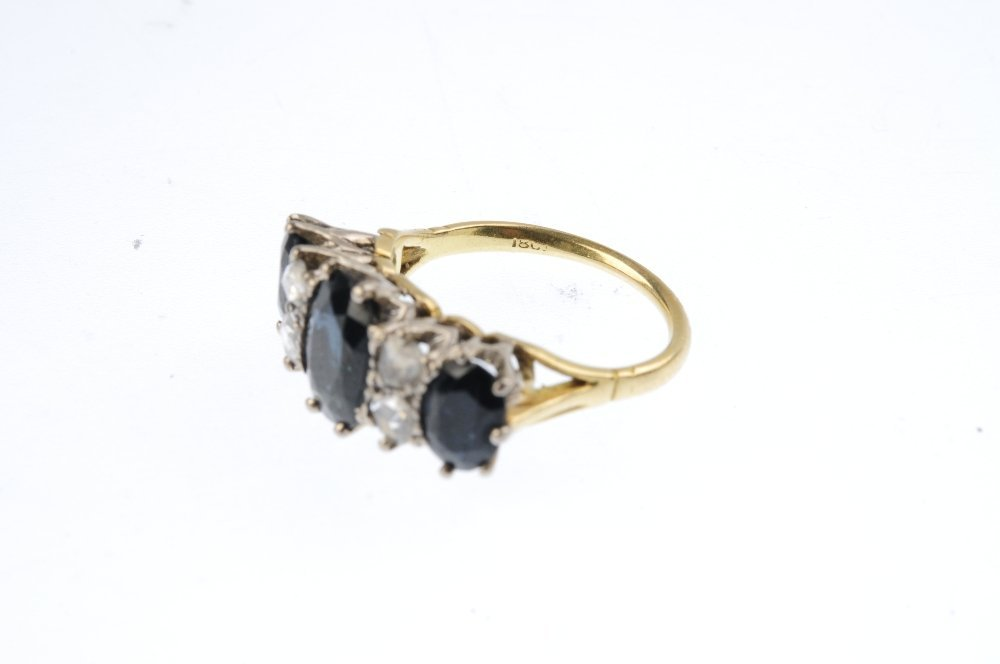 A sapphire and diamond dress ring. The graduated - 3