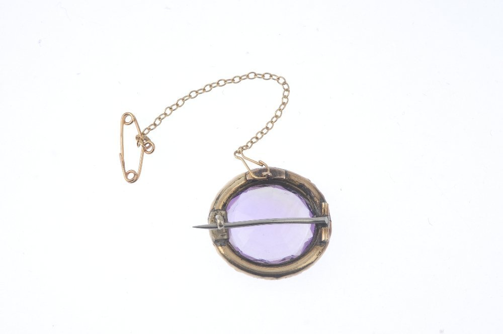 A late Victorian gold amethyst brooch. The oval-shape - 2