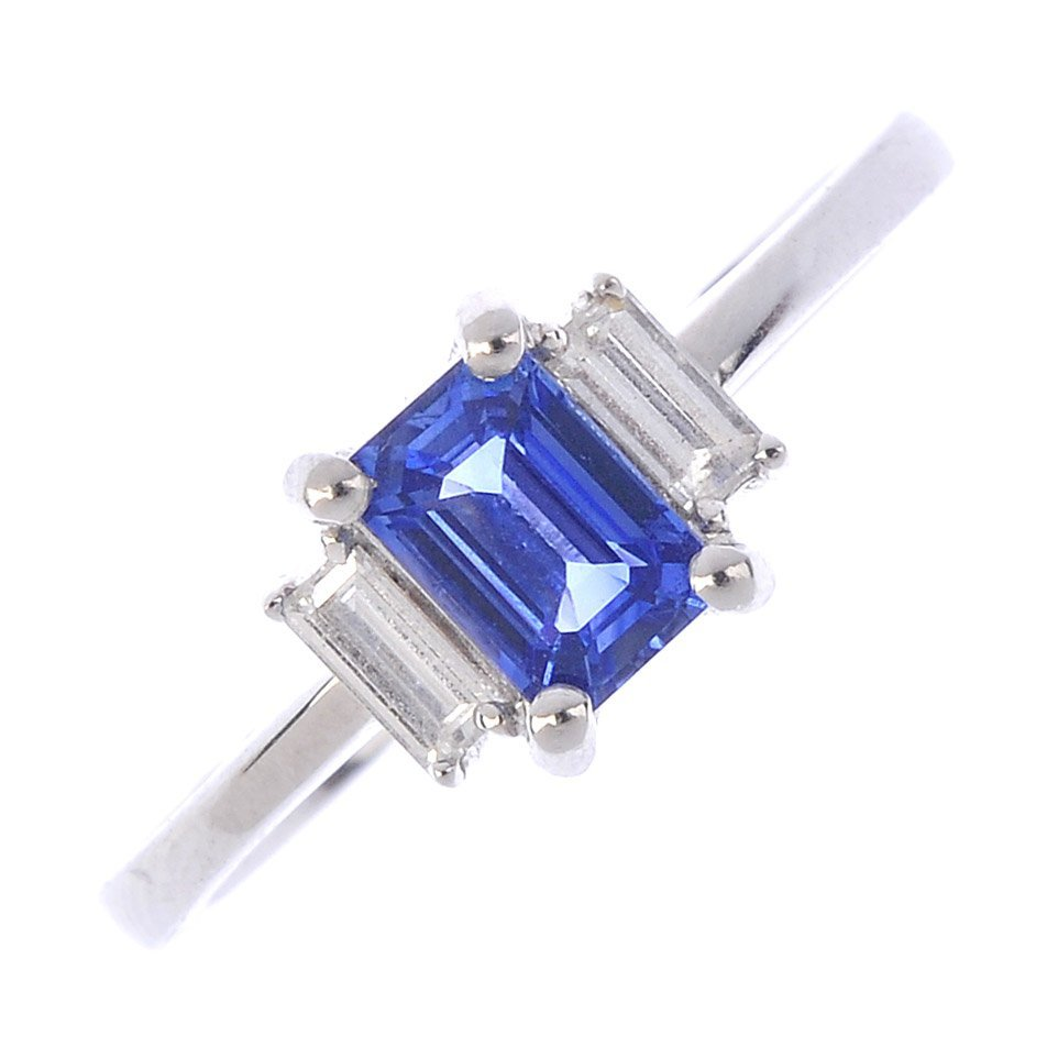 A platinum sapphire and diamond three-stone ring. The