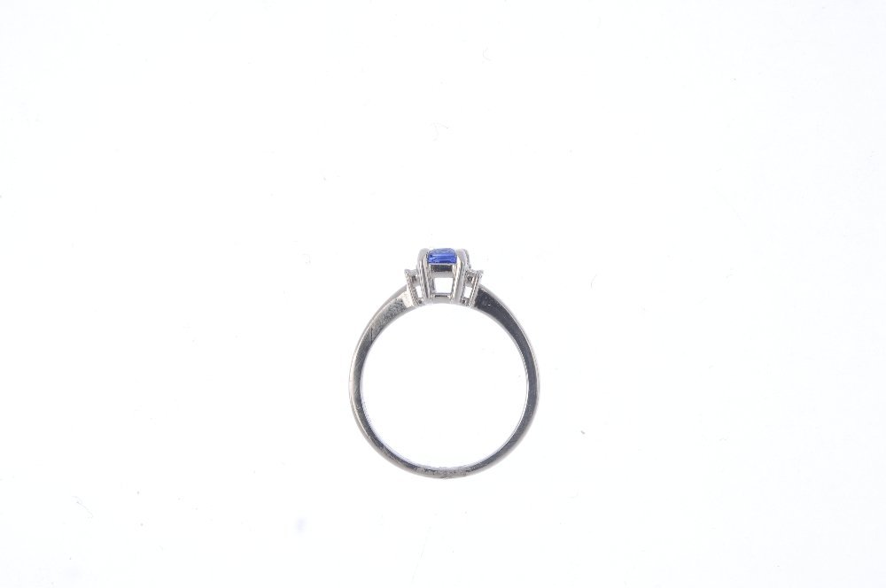 A platinum sapphire and diamond three-stone ring. The - 2