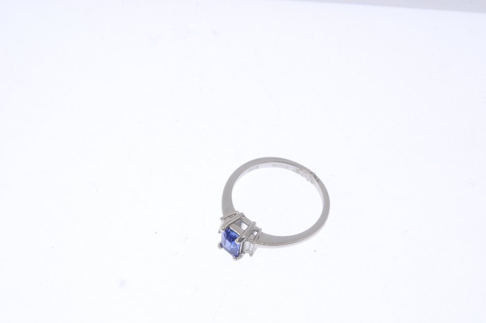 A platinum sapphire and diamond three-stone ring. The - 3