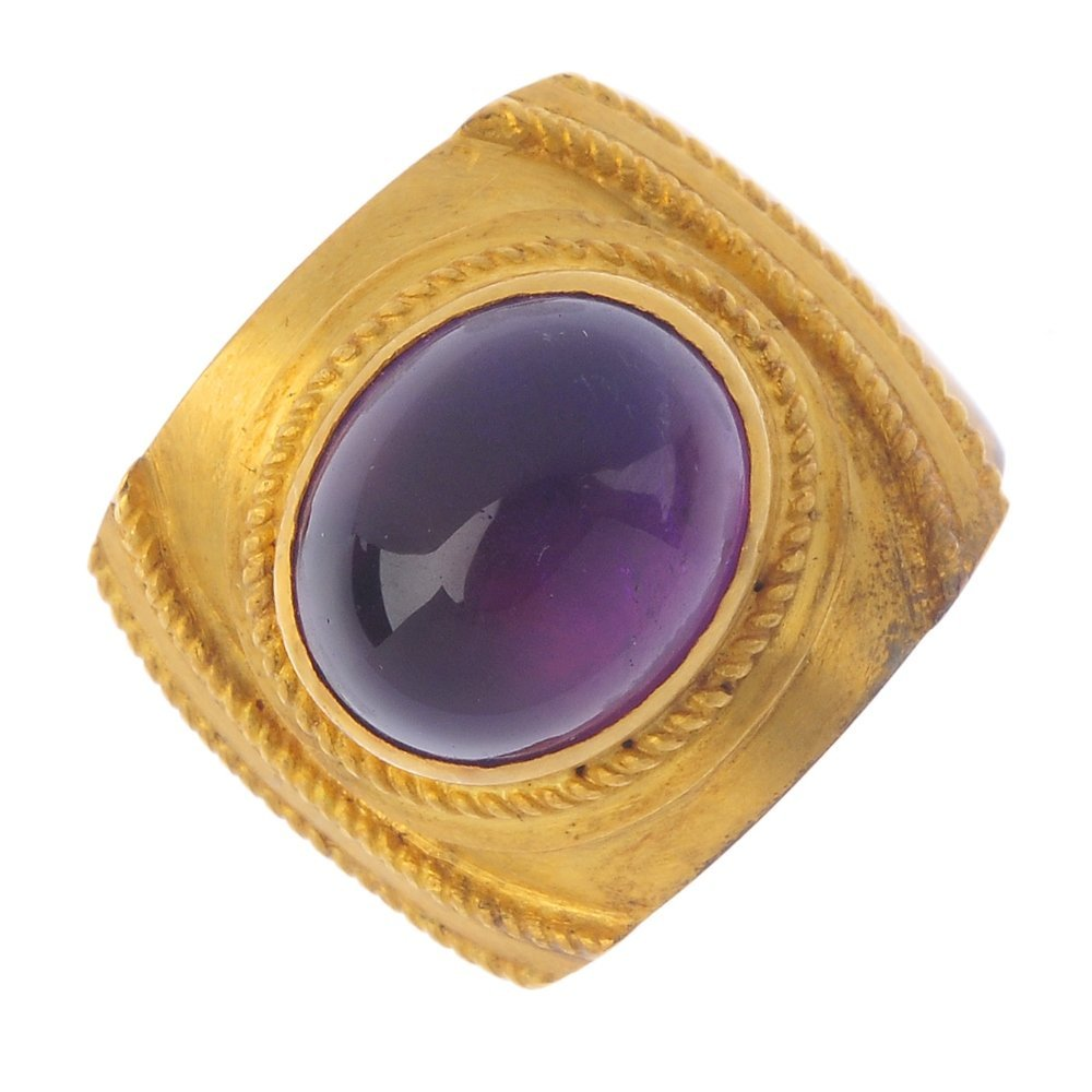 An amethyst single-stone ring. The oval amethyst