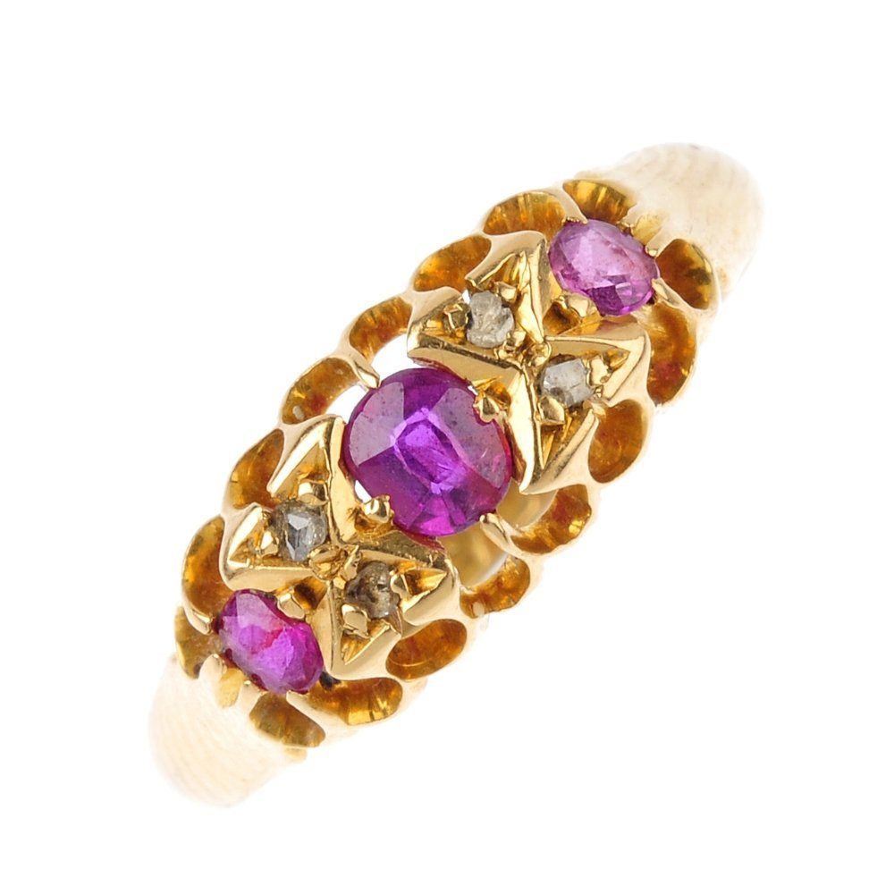 An Edwardian 18ct gold ruby and diamond ring. The