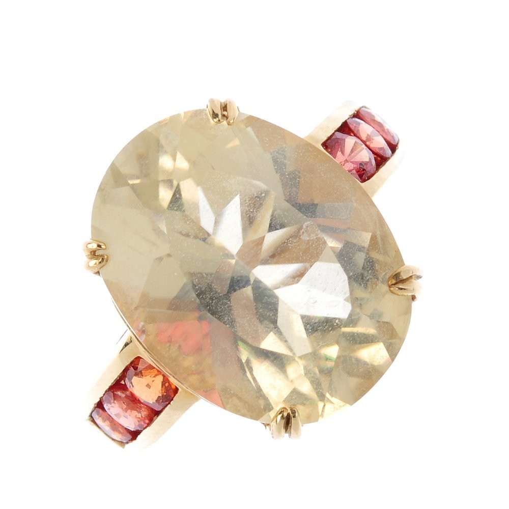 A citrine and gem-set ring. The oval-shape citrine,