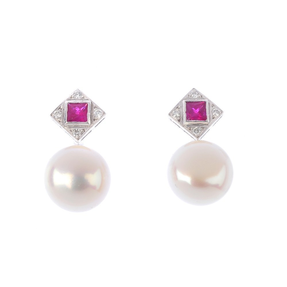 A pair cultured pearl, diamond and ruby earrings. Each