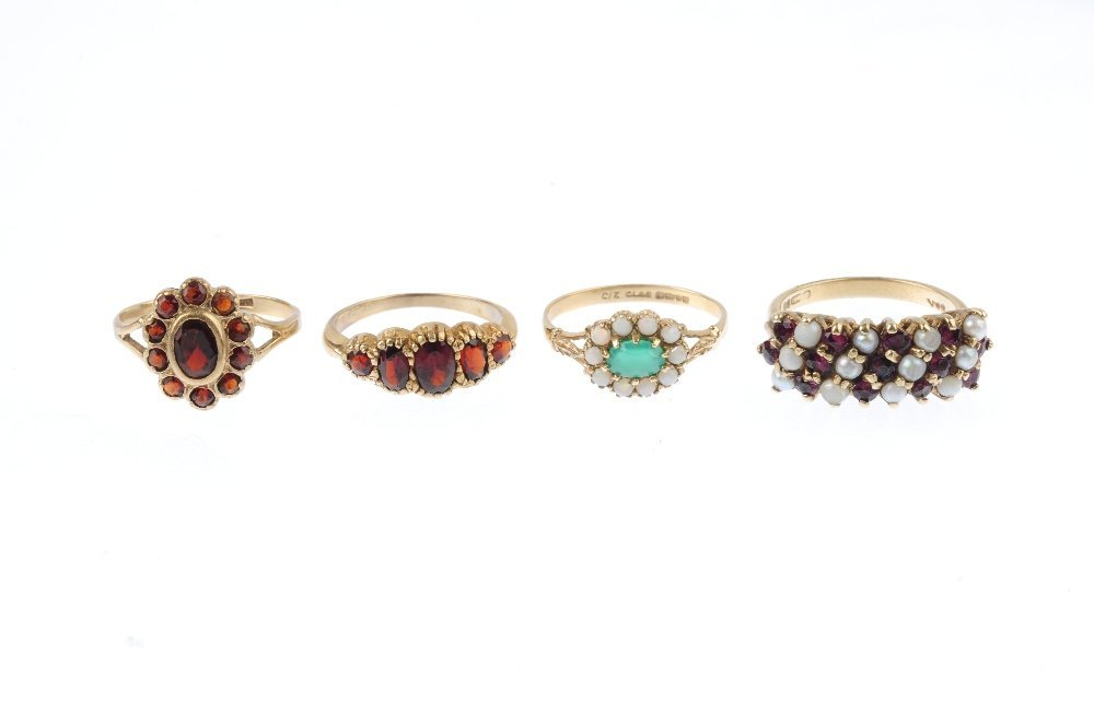 Four 9ct gold gem-set rings. To include a green gem and - 2