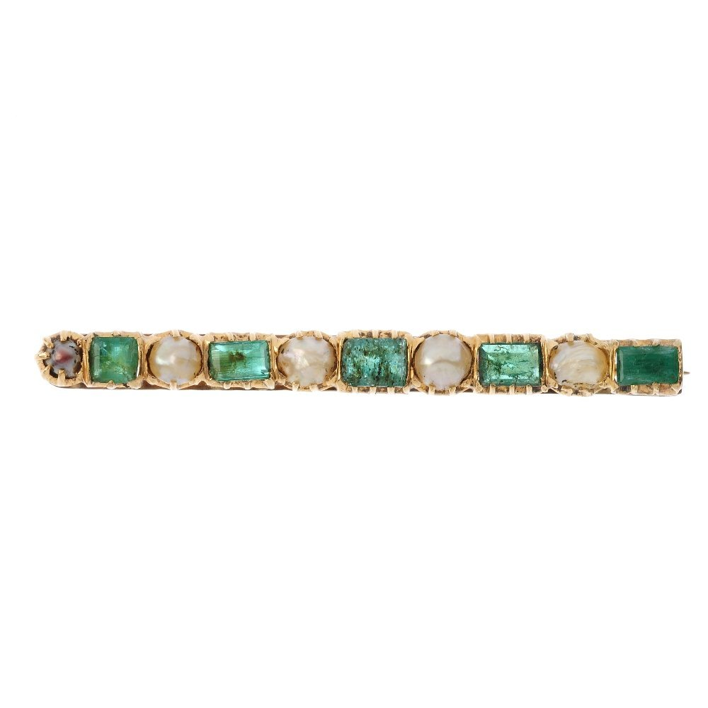 An emerald and pearl brooch. Comprising an alternating