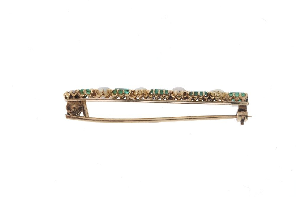 An emerald and pearl brooch. Comprising an alternating - 2