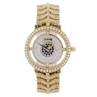 JUVENIA - a lady's bracelet watch. 18ct yellow gold