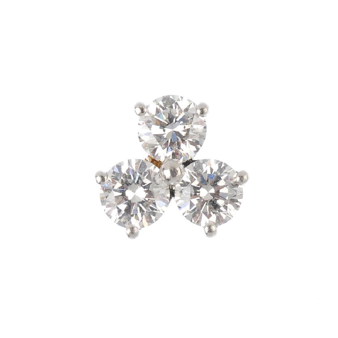 TIFFANY & CO. - a single platinum diamond stud earring.