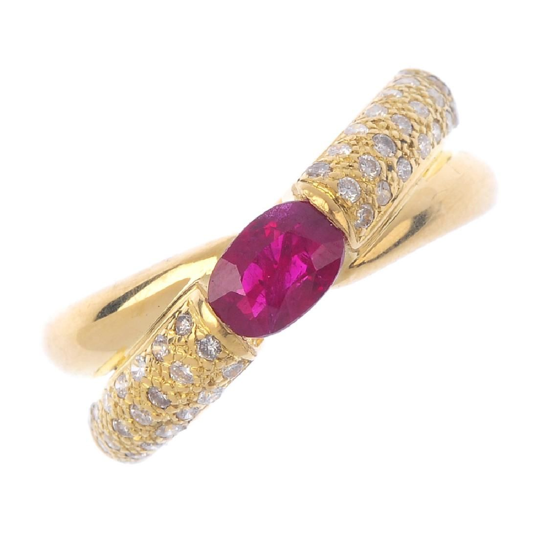 An 18ct gold ruby and diamond ring. The oval-shape