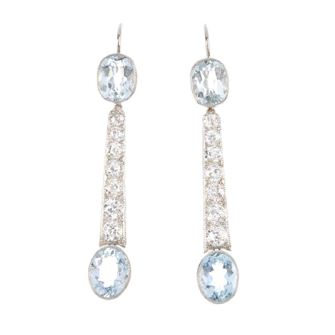 A pair of aquamarine and diamond earrings. Each