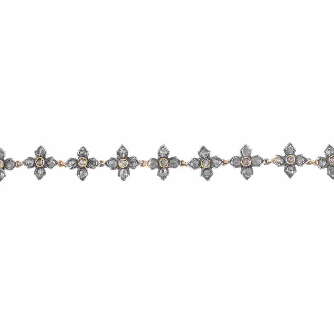 A foil-back diamond bracelet. Designed as a series of
