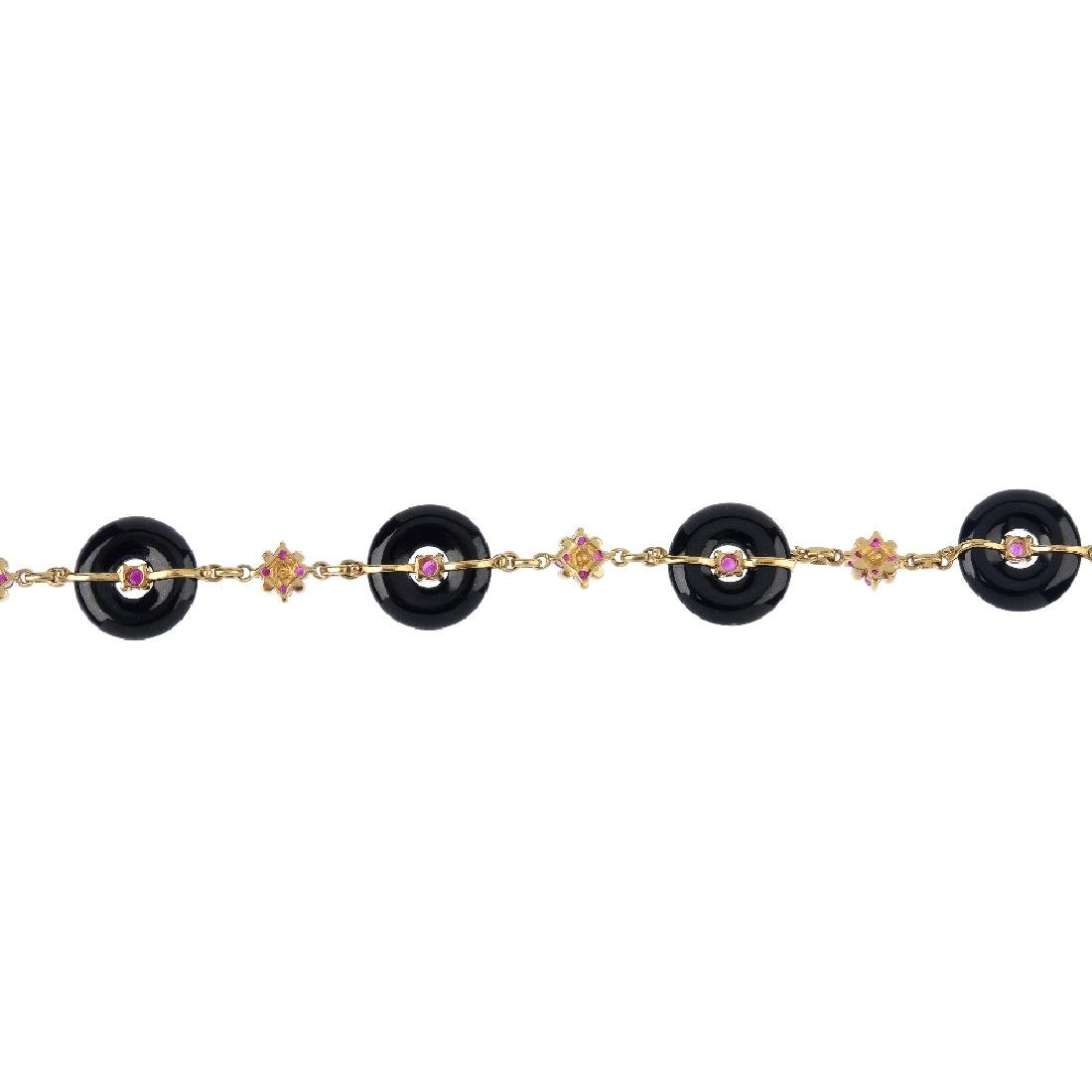 A 9ct gold ruby and onyx bracelet. The ruby and onyx Bi - 2