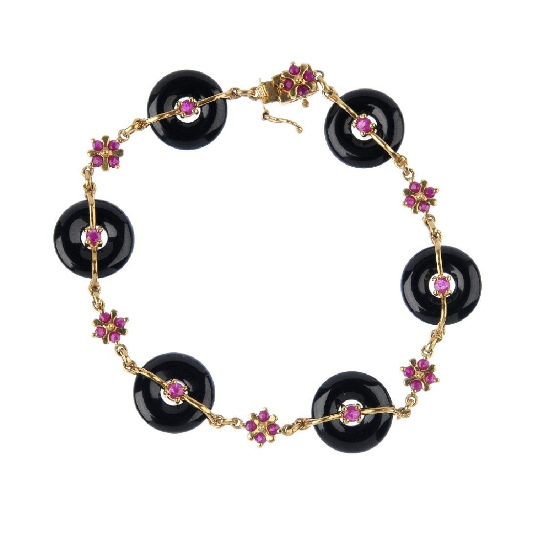 A 9ct gold ruby and onyx bracelet. The ruby and onyx Bi - 3