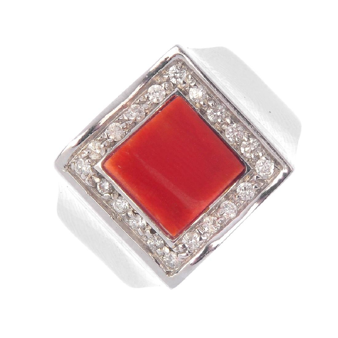 A coral and diamond dress ring. The square-shape coral