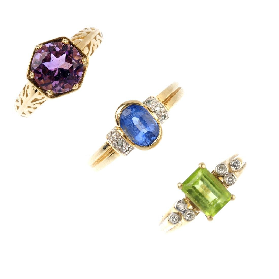 Four 9ct gold gem-set rings. To include an amethyst