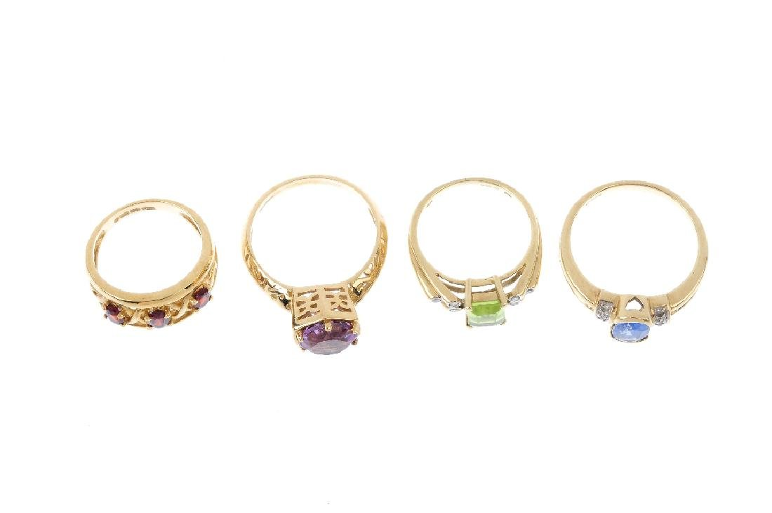 Four 9ct gold gem-set rings. To include an amethyst - 2