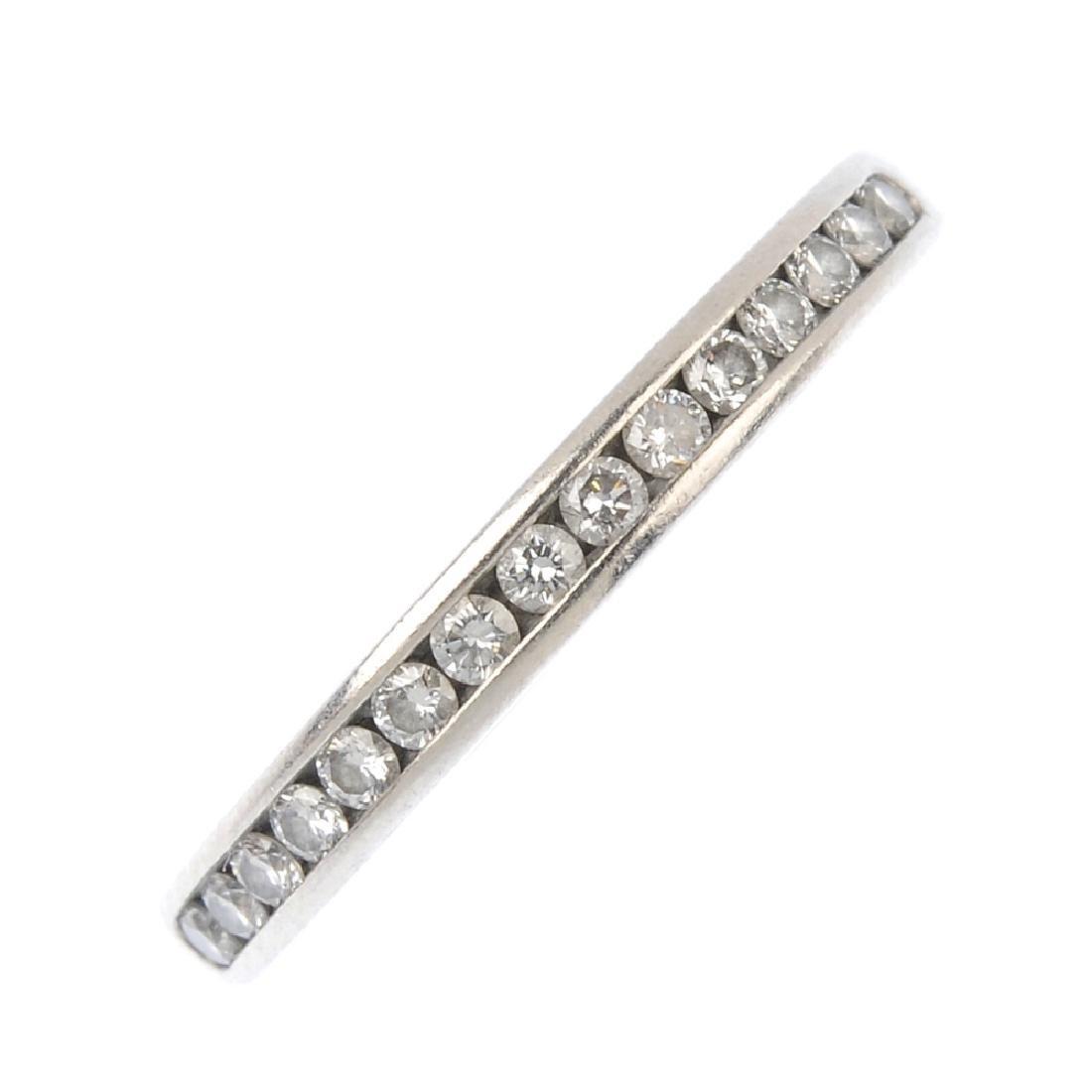 TIFFANY & CO. - a platinum diamond half-circle eternity