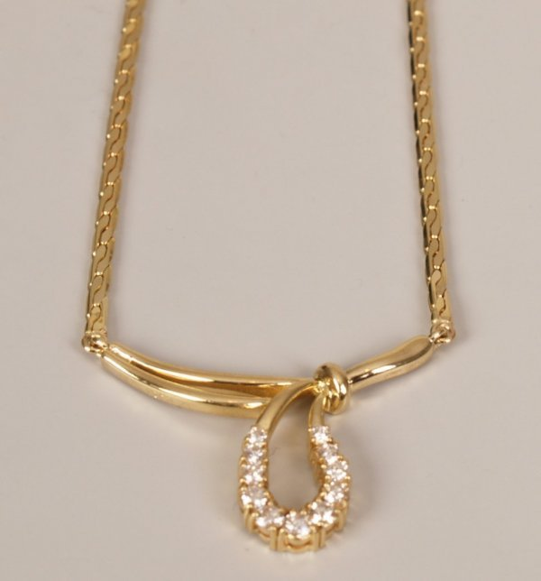 8: 18ct gold diamond necklet with central bow design se