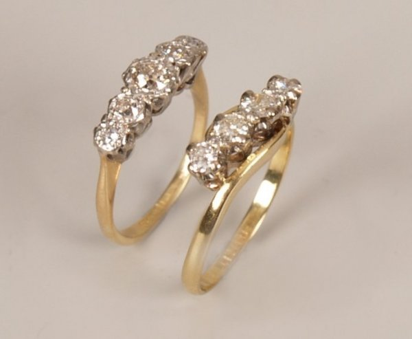 9: Two 18ct gold and platinum mounted rings to include