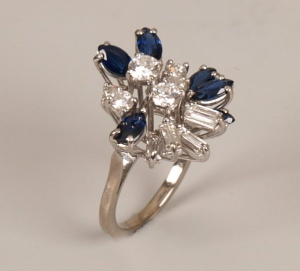 20: Sapphire and diamond set fancy cluster ring, with a
