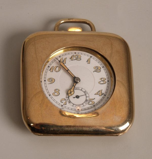 1012: BREVET - a 9ct gold cased travel clock the square