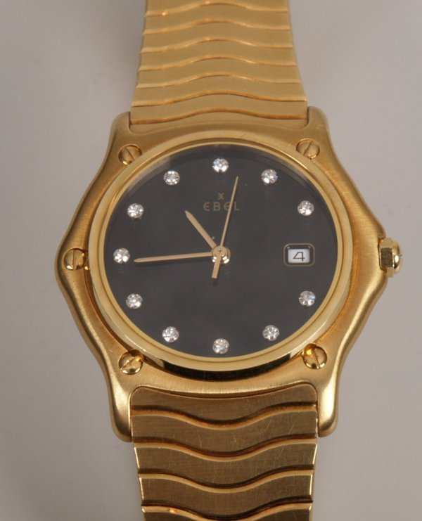 1021: EBEL - a gentleman's 18ct gold mid size sports cl