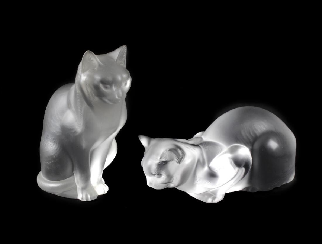 A pair of large Lalique glass cats. The first modelled