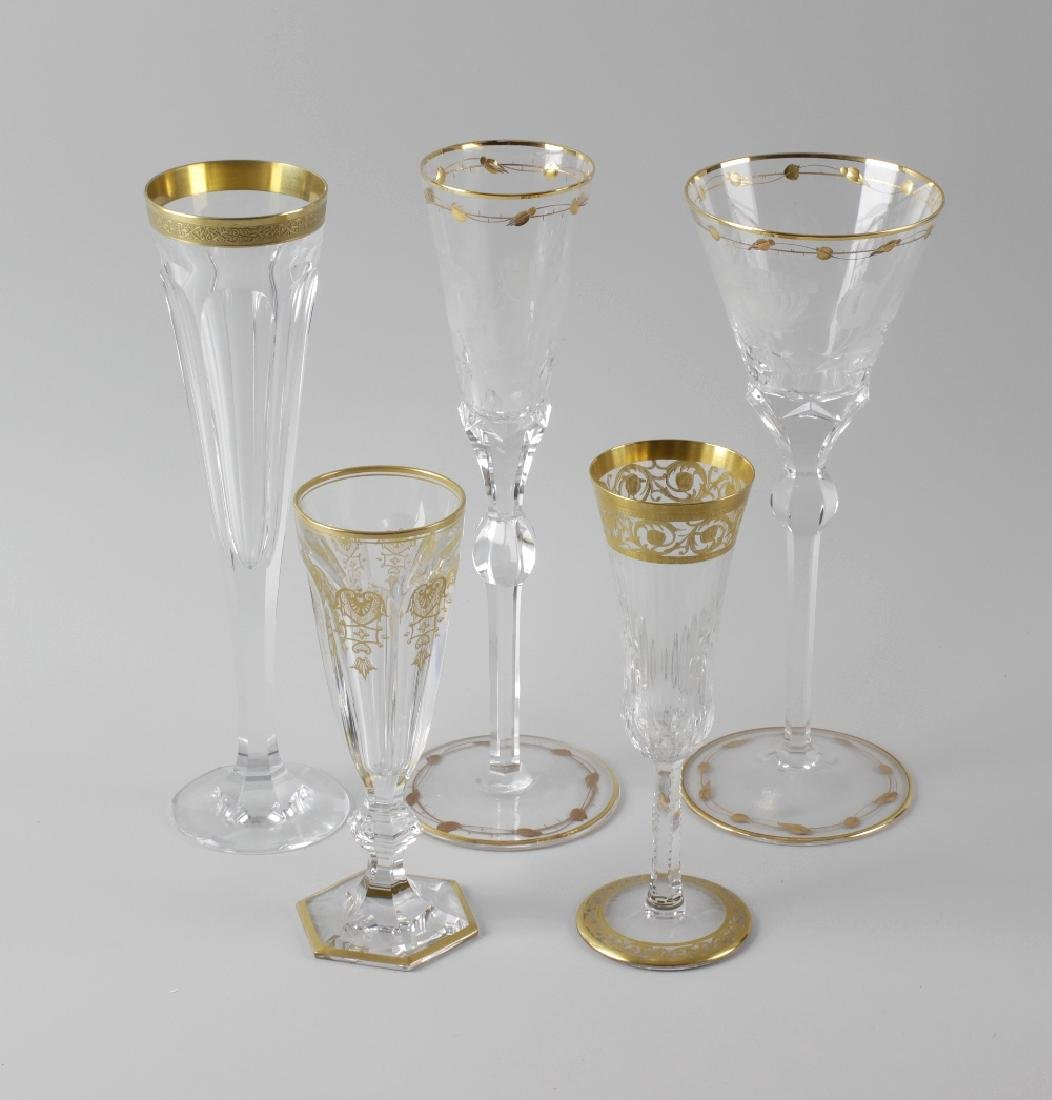 Five pairs of gilt-enriched champagne and wine glasses.