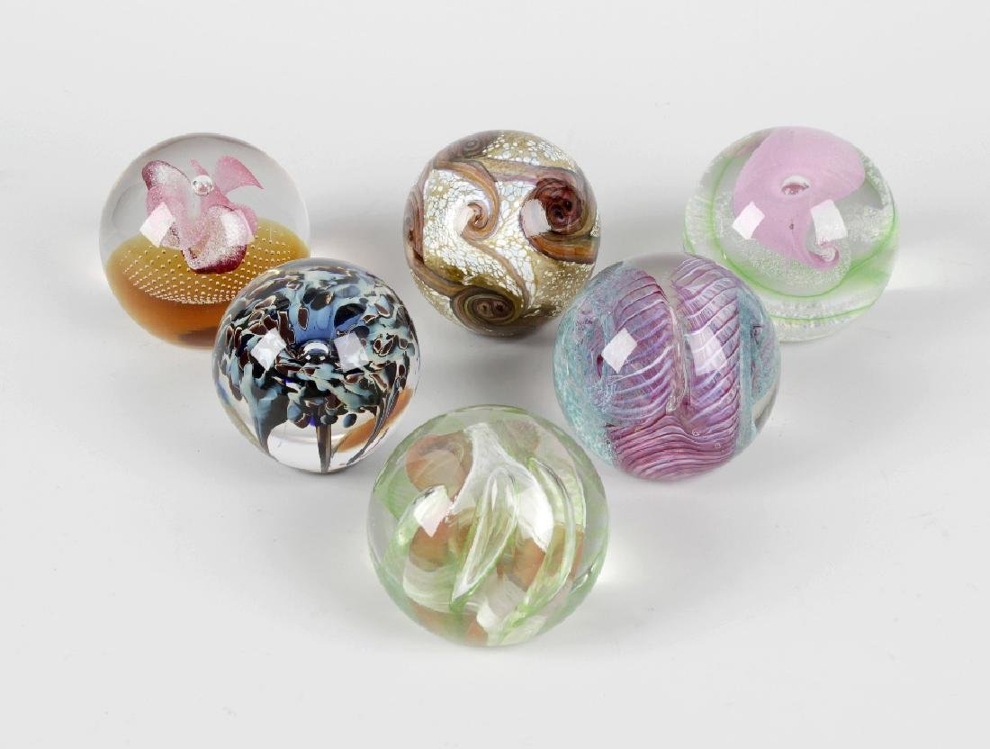 Twenty one various Caithness glass paperweights,