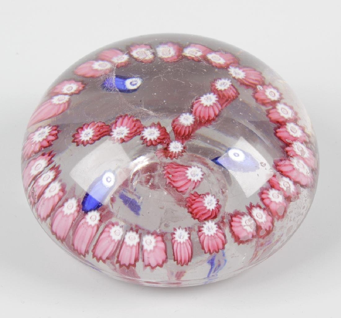 A low domed Old English paperweight, having pink and