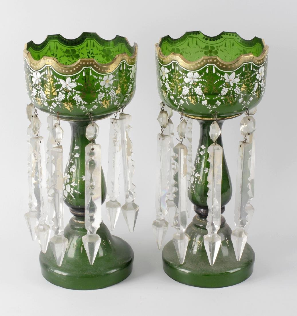 A pair of early 20th century green glass table lustres,