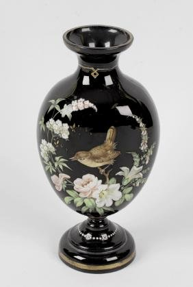A late 19th century glass vase of compressed ovoid