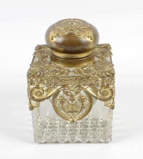 A large late 19th century heavy glass desk inkwell,