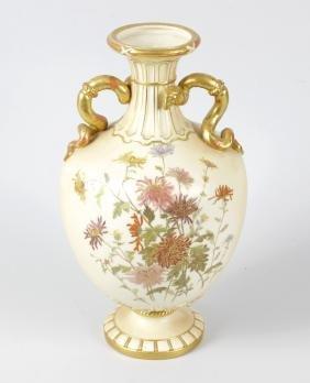 A Royal Worcester china vase of baluster form, the gilt