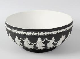 A Wedgwood black jasperware bowl, decorated in the
