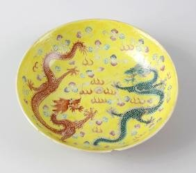 A Chinese porcelain yellow ground bowl. The shallow