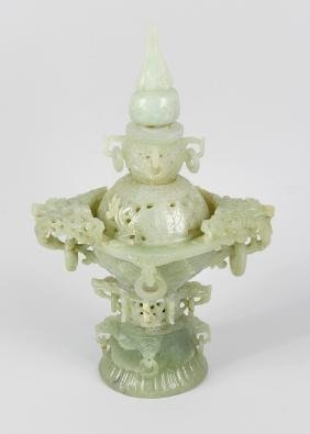 A carved jade incense burner, the domed pierced cover