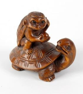 A Japanese carved boxwood netsuke, modelled as a small