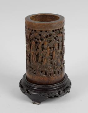 A late 19th century Chinese carved bamboo brush pot,