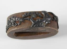 A Japanese bronzed copper fuchi. Probably Meiji period