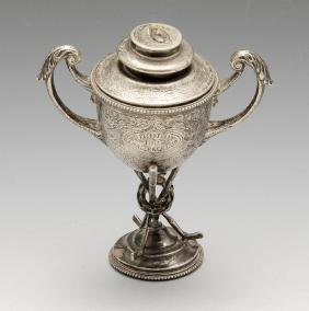 A small Edwardian silver twin-handled trophy cup and