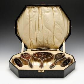 An early twentieth century cased six part silver