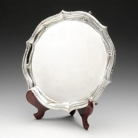 A 1930's silver salver, the shaped circular form with a