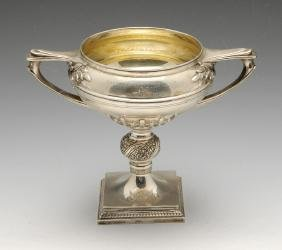 A 1930's silver twin-handled trophy cup, the circular