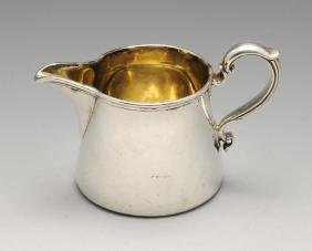A Victorian silver cream jug, the small tapered form