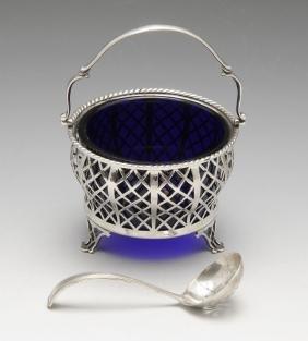 A 1930's silver sugar basket of lattice openwork form,